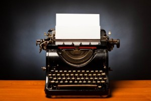 Typewriter-with-blank-sheet-of-paper